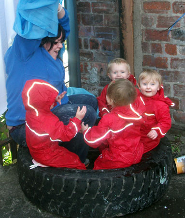 The Task Childcare kids in Puddle Suits