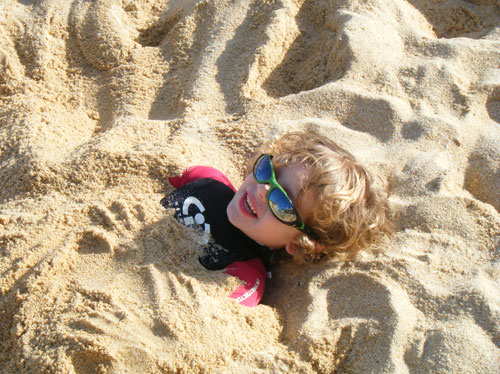 Thomas buried in the beach in TWF wetsuit!